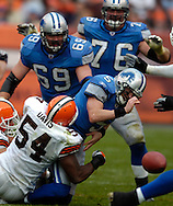 MORNING JOURNAL/DAVID RICHARD.Cleveland's Andra Davis hits quarterback Jeff Garcia of Detroit yesterday in the first quarter. The ball came loose but officials ruled an incomplete pass.