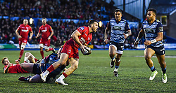 Scarlets' Gareth Davies is tackled by Cardiff Blues' Matthew Rees - Mandatory by-line: Craig Thomas/Replay images - 31/12/2017 - RUGBY - Cardiff Arms Park - Cardiff , Wales - Blues v Scarlets - Guinness Pro 14