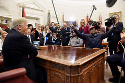 File photo datedOctober 11, 2018 of U.S. President Donald Trump (L) hosts working lunch with artist Kanye West (R) to discuss criminal justice system and prison reform in the Oval Office of the White House in Washington, DC. US rapper Kanye West took to Twitter over the weekend to announce he was running for president, with his declaration quickly going viral and prompting a flurry of speculation. His wife Kim Kardashian West and entrepreneur Elon Musk endorsed him. Photo by Olivier Douliery/ Abaca Press