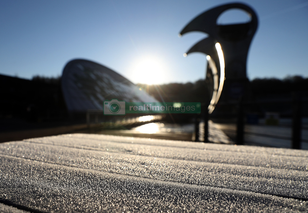 Winter sunshine shines on the Falkirk Wheel, a rotating boat lift which connects the Union and the Forth and Clyde Canals as temperatures dropped overnight.