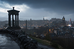 Edinburgh, Scotland, UK. 20 November, 2018. View over the city of Edinburgh from Calton Hill at dusk as heavy rain and wind sweep across the city. Unsettled colder weather is expected to affect much of Scotland over the next few days.