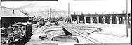 """Looking north at the D&RGW Durango turntable and roundhouse area with several engines on the ready and repair tracks.  At least three others are in the roundhouse.<br /> D&RGW  Durango, CO  Taken by Jackson, Richard B. - ca. 1935<br /> In book """"Durango: Always a Railroad Town (1st ed.)"""" page 25"""