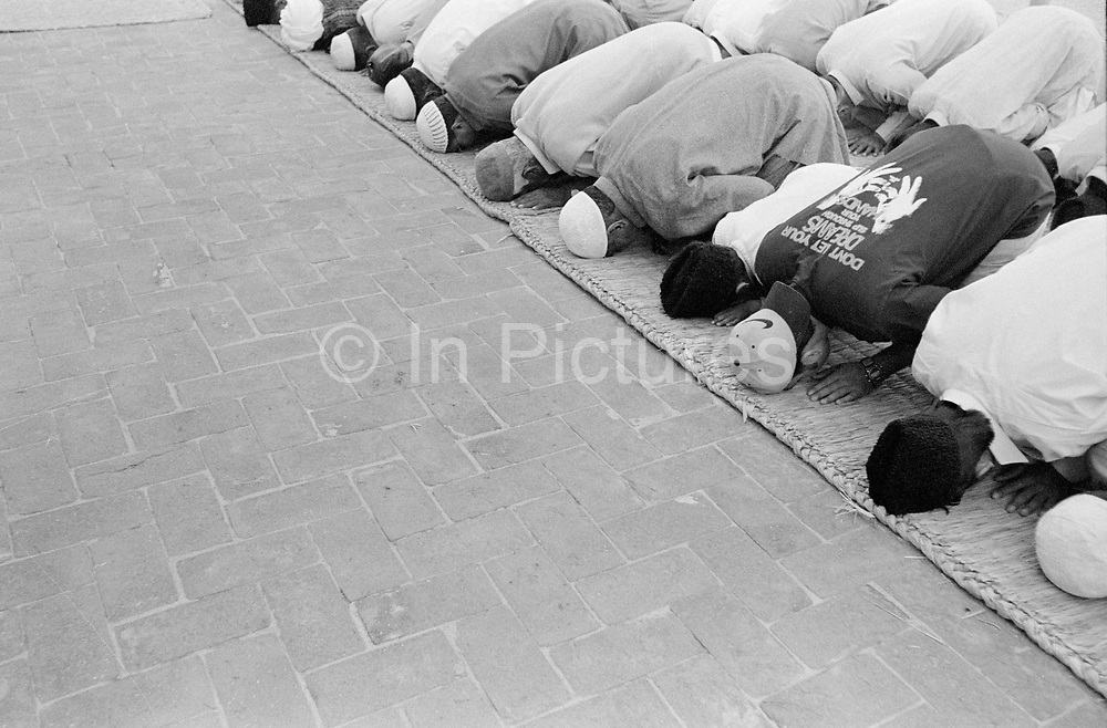 Ahmadiyyas praying at their mosque in Rabwah, Pakistan. Also known as Qadiani's The Ahmadiyyas are the followers of Hazrat Mirza Ghulam Ahmad Qadiani (1835-1908). According to his followers, he was the  founder of the Ahmadiyya Muslim Jama'at and The Promised Messiah and Imam Mahdi. The Ahmadiyya (Qadiani) movement in Islam is a religious organisation with more than 30 million members worldwide. Ahmadiyyas are now banned from calling themselves Muslim in Pakistan and suffer terrible discrimination under anti-blasphemy laws and are regularly murdered for their faith.