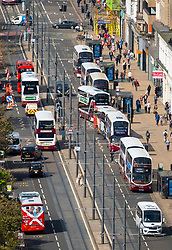 Busy public transport buses  traffic on Princes Street shopping street in central Edinburgh, Scotland, UK