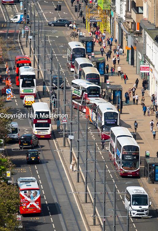 Busy public transport buses  traffic on Princes Street shopping street in central Edinburgh, Scotland, UK