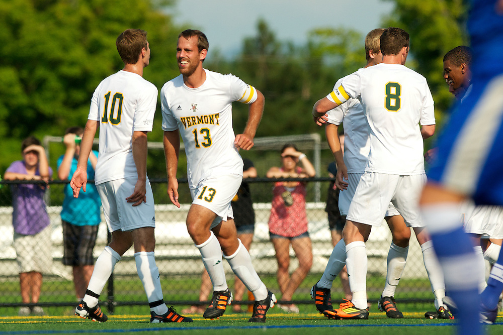 Catamounts defenseman Seth Rebeor (13), Catamounts midfielder Noah Johnson (10) and Catamounts defenseman Joe Losier (8) celebrate a goal by Catamounts forward Jesse Scheirer (7) (not pictured) during the men's soccer game between the Central Connecticut State University Blue Devils and the Vermont Catamounts at Virtue Field on Friday afternoon September 7, 2012 in Burlington, Vermont.