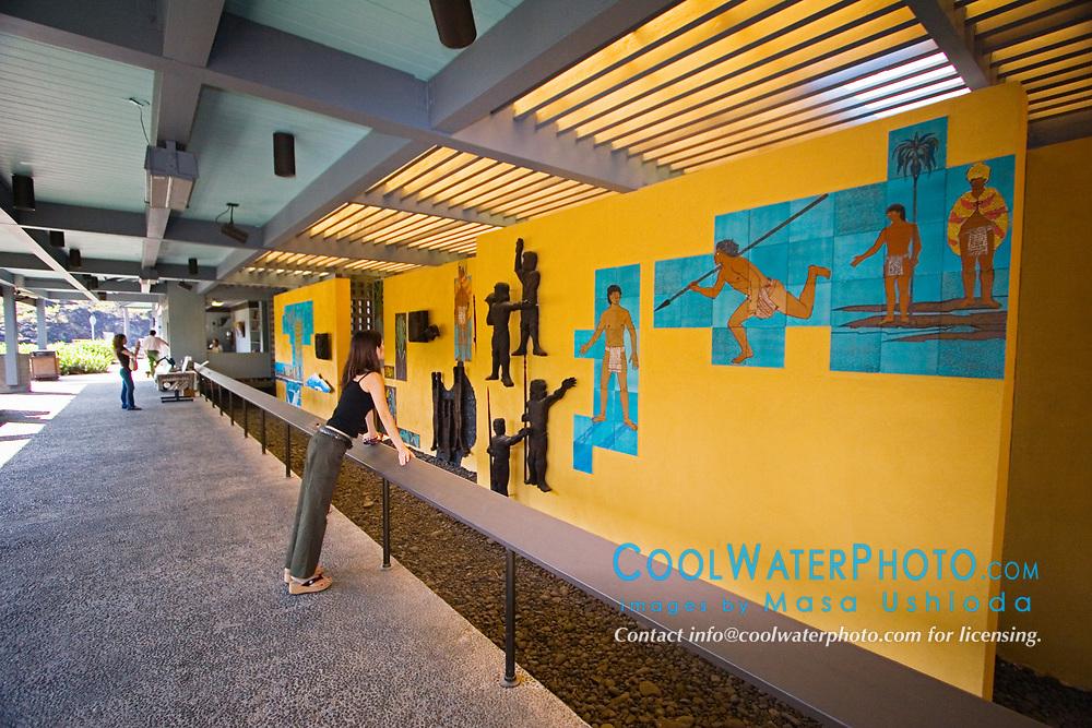 Puuhonua or Pu`uhonua o Honaunau or Place of Refuge National Historical Park Visitor Center, exhibiting cultural wall art, Honaunau, Big Island, Hawaii, USA