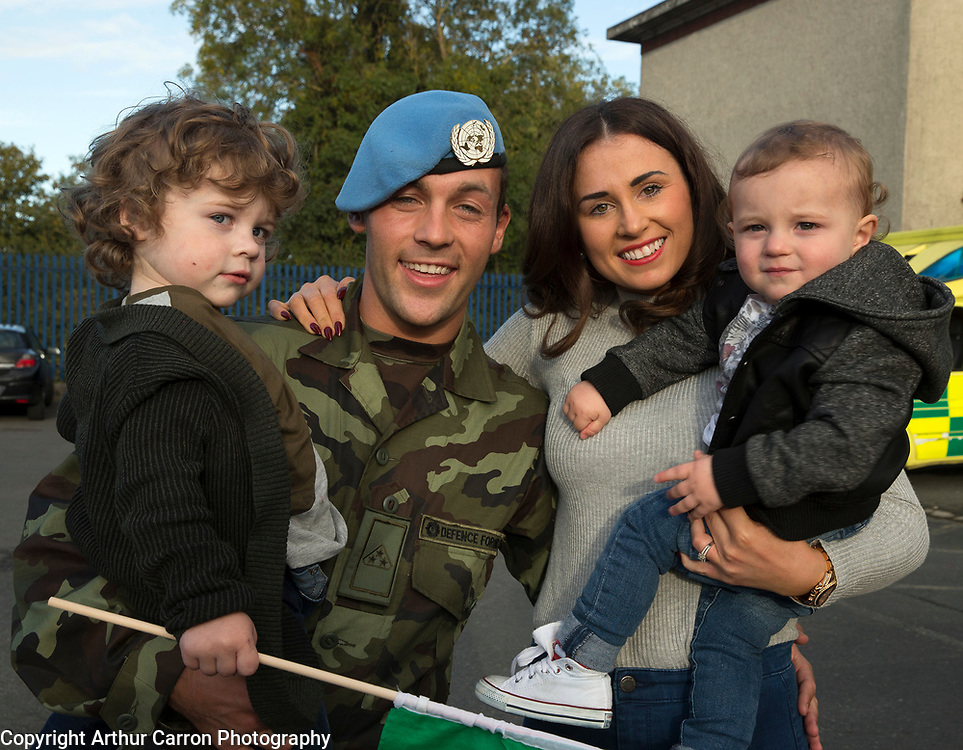 7/10/15 Brian Nolan, Longford welcomed home by his partner Amy Brennan and their sons Charlie, age 2 and Zac, 1, at Casement Areodrome where Irish Troops Return Home After Completing Six Month Deployment to the Golan Heights Picture:Arthur Carron