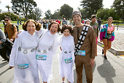 A quartet of characters from the Star Wars film series pose for a photograph at the 107th running of the Bay to Breakers, Sunday, May 20, 2018, in San Francisco. (Photo by D. Ross Cameron)