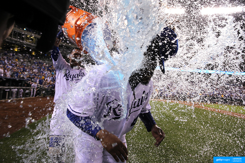 Pitcher Johnny Cueto, Kansas City Royals, is drenched with the gatorade bucket by team mate Salvador Perez after Cueto pitched a nine inning shut out in the Royals 4-0 victory during the Kansas City Royals Vs Detroit Tigers MLB regular season game at Kauffman Stadium, Kansas, Missouri, USA. 10th August 2015. Photo Tim Clayton