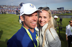 Team Europe's Paul Casey (left) and girlfriend Pollyanna Woodward celebrate after Europe win the Ryder Cup during the Singles match on day three of the Ryder Cup at Le Golf National, Saint-Quentin-en-Yvelines, Paris.