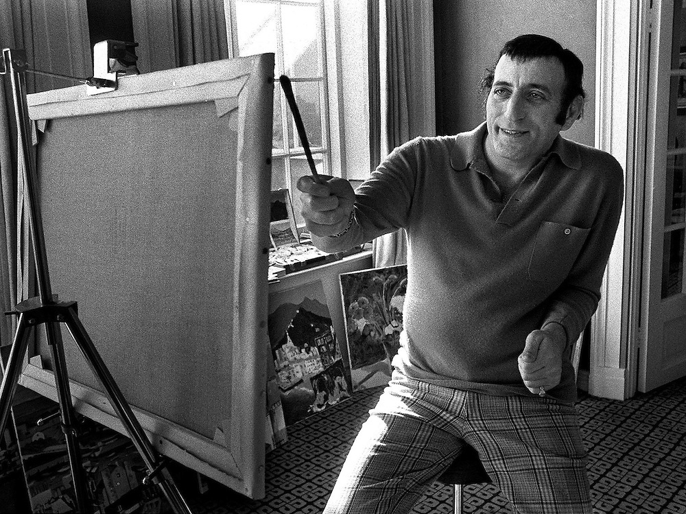 Singer Tony Bennett seen painting  in 1973. A keen amateur artist he is seen here during a visit to London relaxing with his paints and easel. Photographed by Terry Fincher