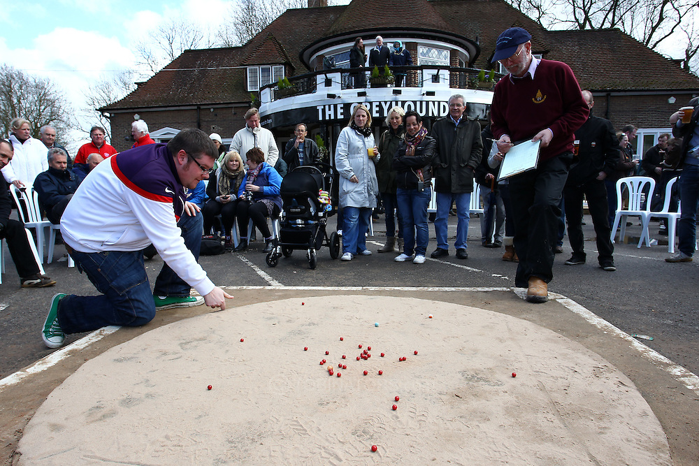 Tinsley Green, Crawley - Friday April 2nd, 2010: A player takes a shot during the World Marble Championships at the The Greyhound, Tinsley Green, Crawley. (Pic by Andrew Tobin/Focus Images)