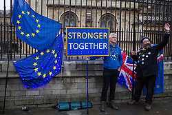 London, UK. 30 January, 2020. Pro-EU activists from SODEM (Stand of Defiance European Movement) stand next to illuminated flags and a placard at a party outside Parliament on the eve of Brexit Day on the theme of 'Party like there's no tomorrow'.