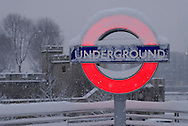 Snow Covered Tower Hill underground station sign, City, London, England, Britain.