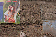 A poster for healthy living with wasteground dereliction in Luxor, Nile Valley, Egypt.