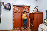 """Eight year old daughter in reception room of the half-built house of the Gregorian family pictured on Thursday, Dec 24, 2020 - in Çartar, which is about 47/km far from Stepanakert (Xankendi) in eastern Nagorno Karabakh.<br /> Alosha was reportedly killed in his position by an Azerbaijani shell the family say. """"He was a sniper shooter"""" his father Alihan remembers. Alosha was the father of three children. Two daughters and one son. From the age of 8 from his daughter to 12 years of his son and 15 years of age of his older daughter.<br /> During 44 days of the war, the region saw an end of the conflict after a ceasefire agreement was signed by the leaders of Armenia, Russia and Azerbaijan on 9 November to end the military conflict in Nagorno-Karabakh. Azerbaijani government established the Karabakh Region Authority (KRU) for the districts of Nagorno-Karabakh that came under Baku's control. The city of Stepanakert (Khankendi) is now under the jurisdiction of the KRU of the Ministry of Justice of Azerbaijan. (Photo/ Vudi Xhymshiti)"""