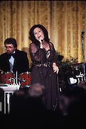 """Loretta Lynn sings in the East Room of the White House as part of an """"In performance at the White House in April 1978<br /> Photo by Dennis Brack"""