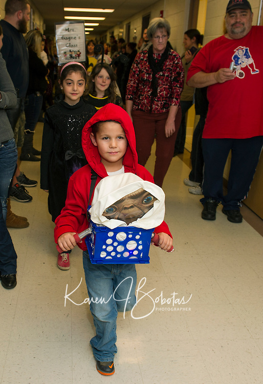 Koen Shosa at Elliott brings E.T. home during the Halloween Parade through the halls of Pleasant Street School Friday afternoon.  (Karen Bobotas/for the Laconia Daily Sun)
