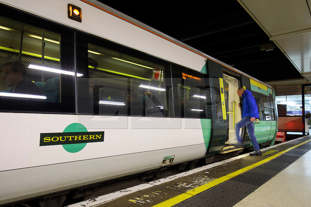 © Licensed to London News Pictures. 06/12/2016. London, UK. Southern Rail passengers get on board a train at Victoria Station in London on 6 December 2016, as hundreds of thousands of rail passengers face a days of travel chaos because of a 72-hour strike in an escalating dispute over the role of conductors between Southern Rail and the RMT Union. Photo credit: Tolga Akmen/LNP