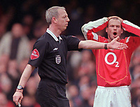 Hand Ball. Referee Mr N. Barry points to the spot as a stunned Fredrik Ljungberg puts his hands to his head.  Sheffield are given a last minute Penalty Arsenal v Sheffield United. FA Cup 5th rd. 19/2/2005. Credit : /Andrew Cowie.