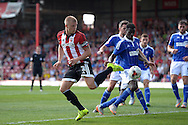 Jake Bidwell, the Brentford captain back flips the ball from a corner. Skybet football league Championship match, Brentford v Ipswich Town at Griffin Park in London on Saturday 8th August 2015.<br /> pic by John Patrick Fletcher, Andrew Orchard sports photography.