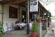 Greece, Epirus, Zagorohoria Taverna Local men at a table