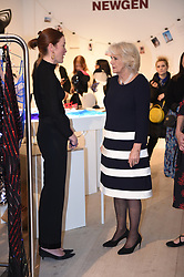 The Duchess of Cornwall (right) backstage during a visit to London Fashion Week at the BFC Show Space, London.