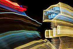 """""""Tahoe Lights 3"""" - Photograph taken at the Lake Tahoe northern state line casinos. The look was achieved by shooting a handheld long exposure and zooming the lens during the exposure."""