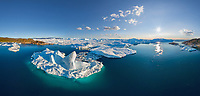 Aerial view of big glaciers in Greenland during the day.
