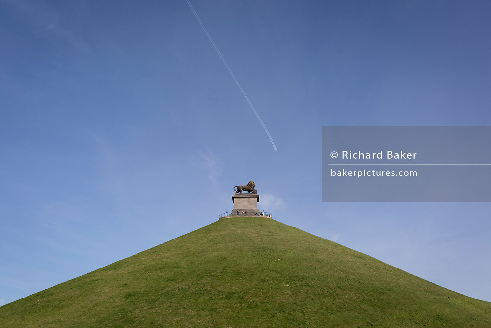 Visitors on the top of  the 43 metre high Waterloo Lion's battlefield Mound, on 25th March 2017, at Waterloo, Belgium. The Lion's Mound (Butte du Lion is a large conical artificial hill completed in 1826. It commemorates the location on the battlefield of Waterloo where a musket ball hit the shoulder of William II of the Netherlands (the Prince of Orange) and knocked him from his horse during the battle. From the summit, the hill offers a 360 degree vista of the battlefield. The Battle of Waterloo was fought 18 June 1815. A French army under Napoleon Bonaparte was defeated by two of the armies of the Seventh Coalition: an Anglo-led Allied army under the command of the Duke of Wellington, and a Prussian army under the command of Gebhard Leberecht von Blücher, resulting in 41,000 casualties.
