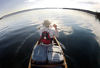 A canoist paddles the calm morning waters of Shoshone Lake on Sunday in Yellowstone National Park. The lake, accessible via a water channel from Lewis Lake to the south, is considered the largest backcountry lake in the lower 48 states that cannot be accessed by a road.