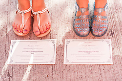 "© Licensed to London News Pictures. 18/07/2015. London, UK. (L to R) Kaitlyn Totten and Emily McClarence, both from Manchester, were the first to arrive in the queue at 4am.  They hold certificates confirming that they took part in the open casting.  Thousands of girls, aged between eight and 12, converge on ExCel London to attend Warner Brothers' open casting for the role of ""Modesty"" in the forthcoming Harry Potter spin-off, Fantastic Beasts and Where to Find Them.  The studio is searching for a ""haunted young girl with an inner strength and stillness"".  Whoever is selected will play alongside a star studded cast, including Eddie Redmayne, and with a screenplay written by Harry Potter author, JK Rowling. Photo credit : Stephen Chung/LNP"