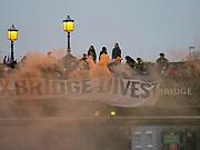 Greater London. United Kingdom, 164th. Spectators on Hammersmith Bridge with flares. Men's  University Boat Race, Cambridge University vs Oxford University. Putney to Mortlake,  Championship Course, River Thames, London. <br /> <br /> Saturday  24/03/2018<br /> <br /> [Mandatory Credit:Intersport Images]