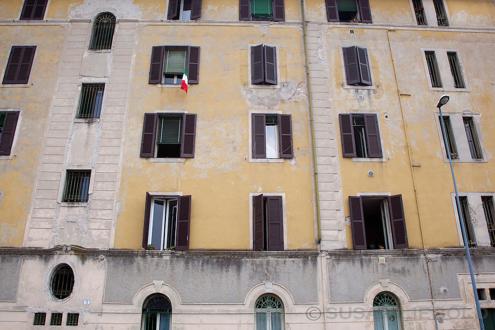 The Italian flag hanging from a window of a large apartment building in Verona, Italy.