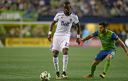 September 27, 2017 - Seattle, WASHINGTON, U.S - BERNIE IBINI (23) in action against VICTOR RODRIGUEZ (8) as the Vancouver Whitecaps visit the Seattle Sounders for an MLS match at Century Link Field in Seattle, WA. (Credit Image: © Jeff Halstead via ZUMA Wire)