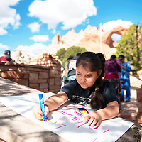 """Rozario Long, 6, creates a poster which reads, """"I love Indigenous People"""" Monday, Oct. 14 during an Indigenous Peoples Day celebration at the Navajo Tribal Park & Veteran's Memorial in Window Rock."""