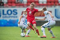 Fotball<br /> 29.05.2016<br /> Tippeligaen<br /> Brann Stadion<br /> Brann - Haugesund 1- 0 <br /> Filip Kiss (L) og Vegard Skjerve (R) , Haugesund<br /> Erik Huseklepp (M) , Brann<br /> Foto: Astrid M. Nordhaug