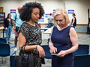 """24 MAY 2019 - WEST DES MOINES, IOWA: US Senator KIRSTEN GILLIBRAND (D-NY), right, talks to ALEXANDRIA PHILLIPS, the campaign's traveling press secretary, after Gillibrand's forum on family rights in the West Des Moines Public Library. Gillibrand unveiled her """"Family Bill of Rights"""" during a forum in West Des Moines. The New York Senator has made family health and rights a centerpiece of her campaign. She is touring Iowa this week to support her candidacy to be the Democratic nominee for the US Presidency. Iowa traditionally hosts the the first selection event of the presidential election cycle. The Iowa Caucuses will be on Feb. 3, 2020.           PHOTO BY JACK KURTZ"""