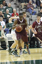 15 December 2012:  Nate Brooks storms the lane during an NCAA mens division 3 basketball game between theUniversity of Chicago Maroons and the Illinois Wesleyan Titans in Shirk Center, Bloomington IL