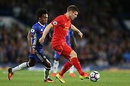 James Milner of Liverpool in action with Willian of Chelsea marking. Premier league match, Chelsea v Liverpool at Stamford Bridge in London on Friday 16th September 2016.<br /> pic by John Patrick Fletcher, Andrew Orchard sports photography.