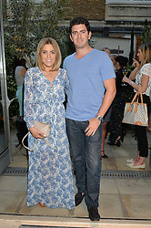 OLIVIA COX and MIKE VAN RENSBURG at a party to celebrate the launch of Le Jardin de Monsieur Li by Hermes in association with Mr Fogg's was held at Hermes, 155 New Bond Street, London on 9th July 2015.