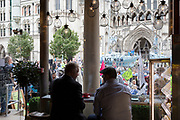 "Seen through the window of a nearby cafe, environmental and climate change protesters block Fleet Street on the first day of a week-long country-wide protests using using five boats to stop traffic in Cardiff, Glasgow, Bristol, Leeds, and London, on 15th July 2019, in London, England. The group is calling on the government to declare a climate emergency, saying it was beginning a five-day ""summer uprising"" and that 'Ecocide' ought to be a criminal offence in law."