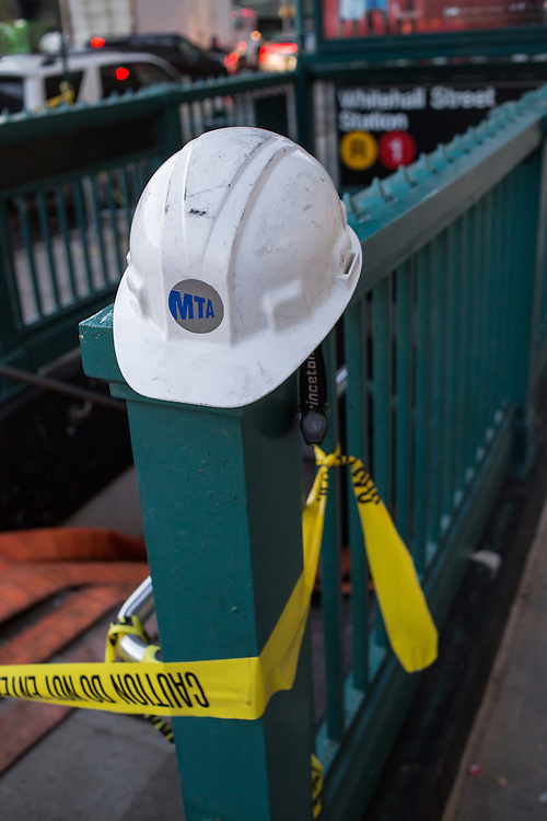 An MTA hardhat rests on the rail of the entrance to the Whitehall Street subway station, still closed a week after hurricane Sandy hit.