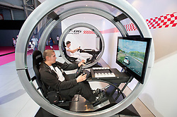 Visitors using Toyota driving simulators at Paris Motor Show 2010