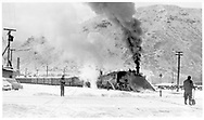"""D&RGW double-headed freight leaving Durango northbound with #463 leading with its large wedge pilot plow and #473 as the road engine.  There's only a little snow here, but likely much more on the way to Silverton.<br /> D&RGW  Durango, CO  Taken by Richardson, Robert W. - 2/13/1953<br /> In book """"Durango: Always a Railroad Town (1st ed.)"""" page 102"""