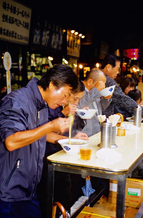 Eating at a noodle shop on the street at the Tokyo Central Wholesale Market, Tsukiji, Tokyo, Japan
