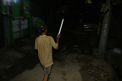 June 10, 2017 - Bekasi Regency, West Java, Indonesia - A number of teenage boys beat percussion from ex-paint bucket and bamboo when waking people to pre-dawn meals, or known Sahur, in wanasari Village, Bekasi regency, West Java, Saturday, June 10, 2017. Awakening the people to sahur in the holy month of Ramadhan is a tradition that still survive in Indonesia amid technological advances such as alarm. (Credit Image: © Tubagus Aditya Irawan/Pacific Press via ZUMA Wire)
