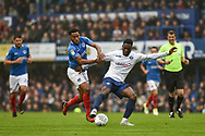 Portsmouth Midfielder, Jamal Lowe (10) and Wycombe Wanderers Forward, Fred Onyedinma (19) during the EFL Sky Bet League 1 match between Portsmouth and Wycombe Wanderers at Fratton Park, Portsmouth, England on 22 September 2018.