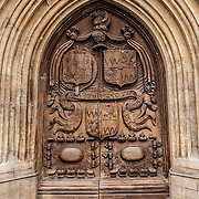 A heavy wooden oak door on the West Front of Bath Abbey, Bath, Somerset.